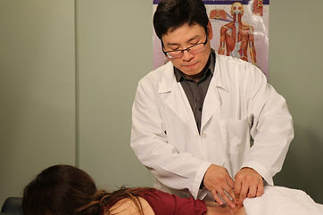Dr. Eric Wei Wang helps Nicole S. with Back Pain