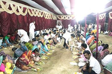 Prasadam distribution to devotees.