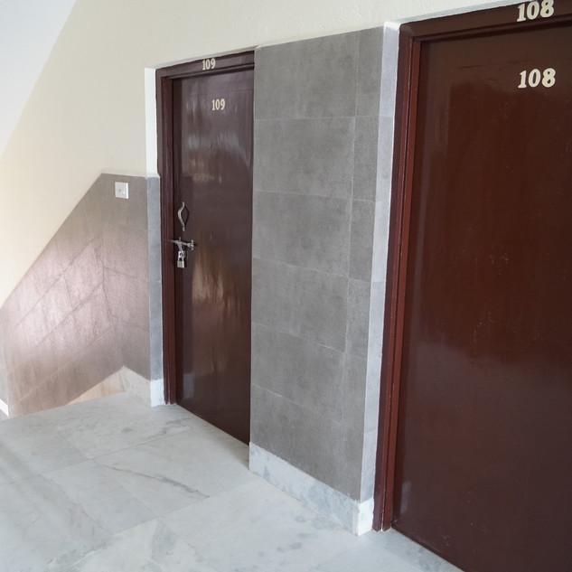 Marble flooring, steel handrails, and well lighted halls.