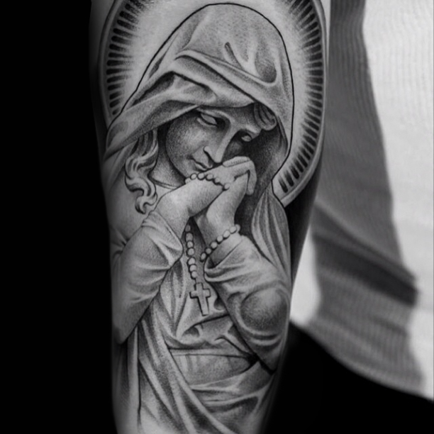 Praying virgin mary tattoo