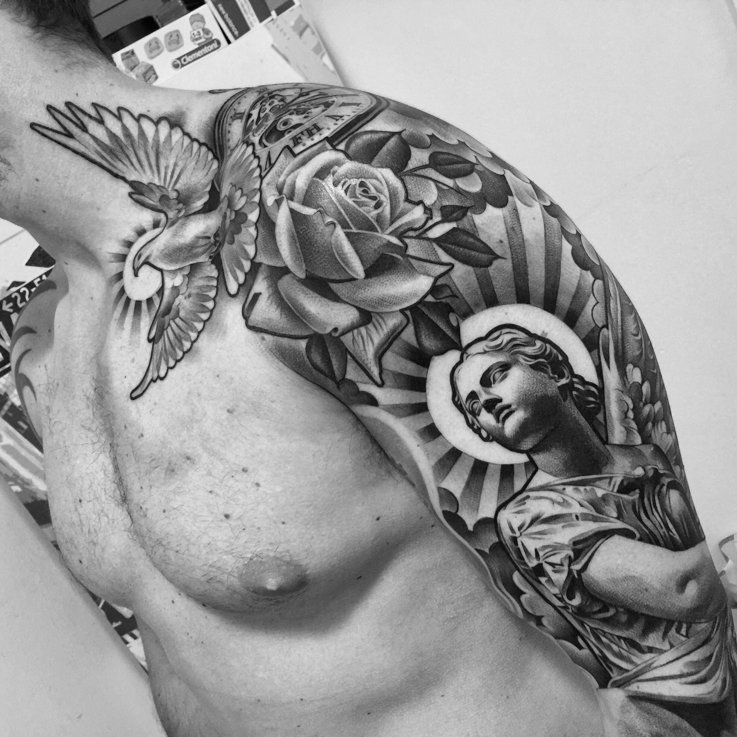 statue and dove tattoo