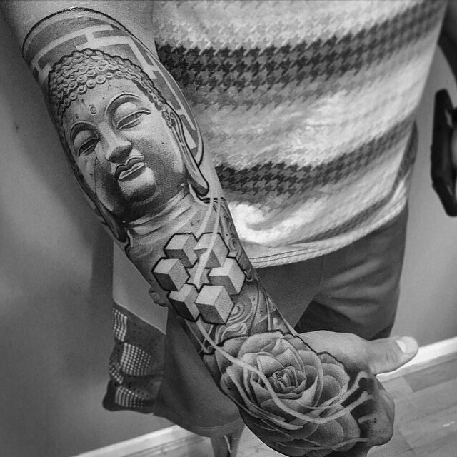 buddha with flower tattoo.jpg