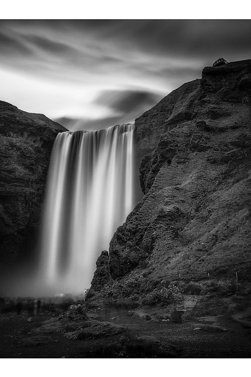 A black and white print for sale of Skógafoss, Iceland by travel and fine art photographer Murray Sye