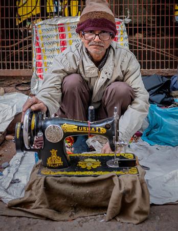 0522_Delhi Man Sewing_COL_17 x 22.jpg
