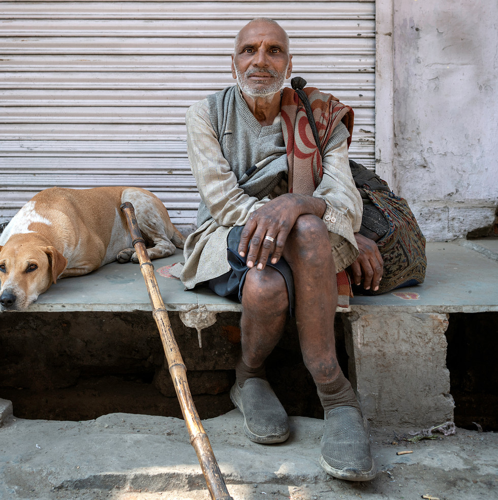 3160_Udaipur Man with dog_COL_22 x 17.jp