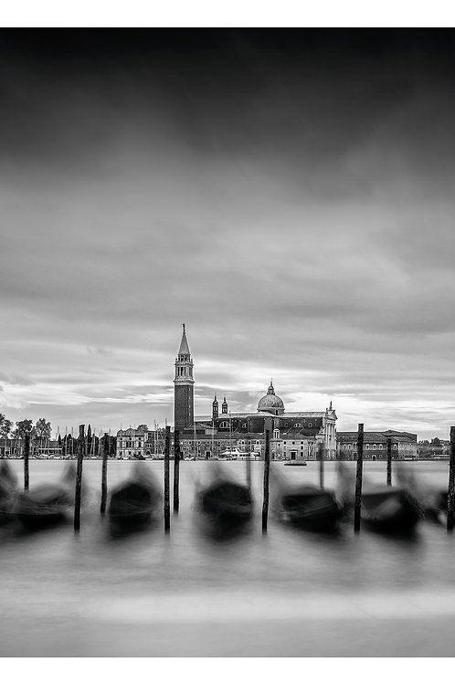 A black and white print for sale of gondolas in Venice Italy by travel and fine art photographer Murray Sye