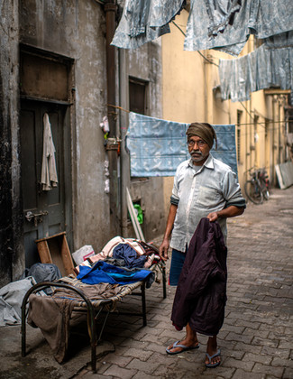0100_Delhi Man in Alley_COL_17 x 22.jpg