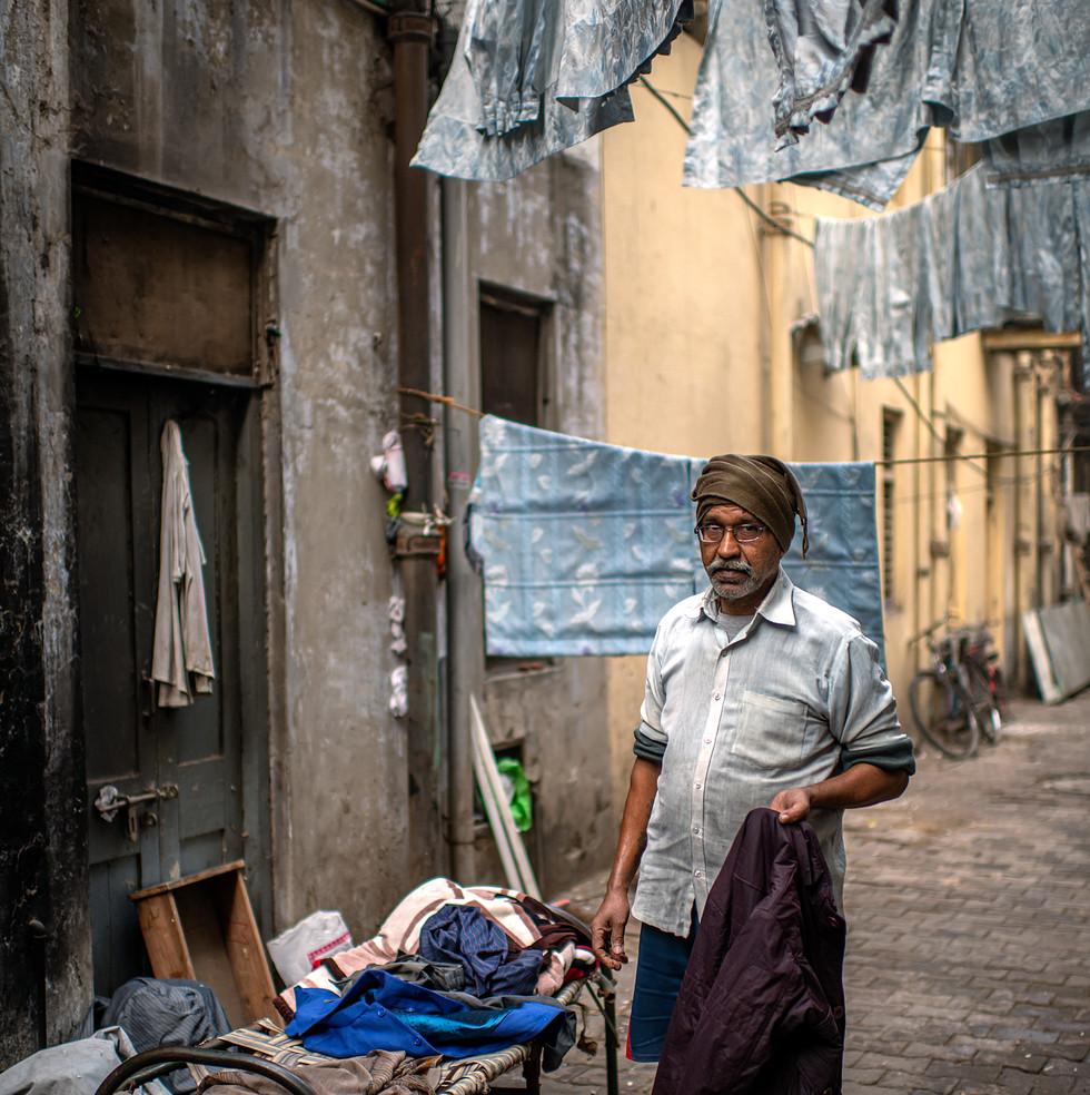 0100_Delhi-Man-in-Alley_COL_17-x-22.jpg