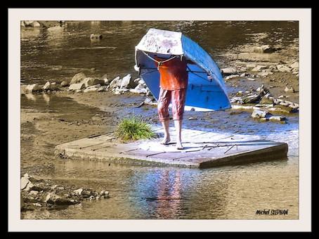 L'homme avec sa barque