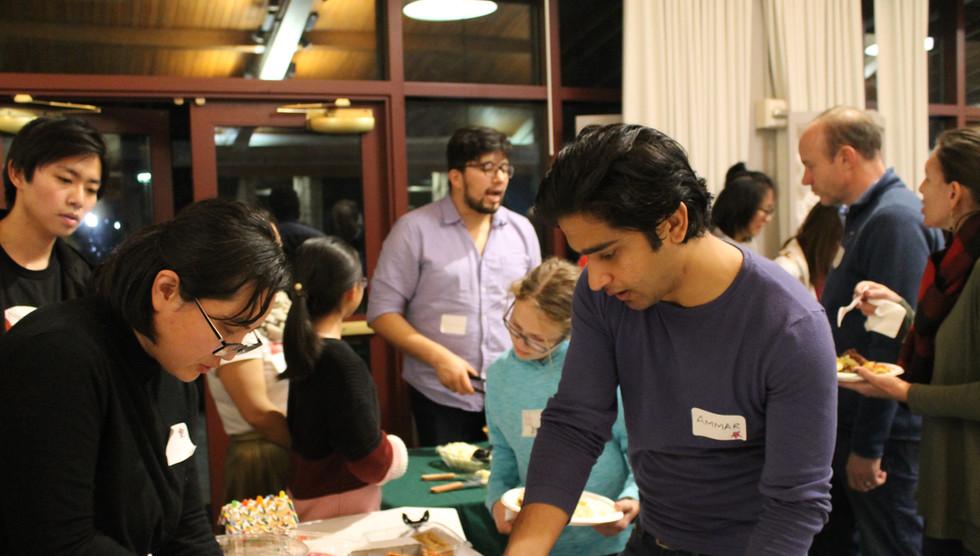 Serving food at the International Potluck