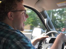 Quentin loves driving the passenger van!