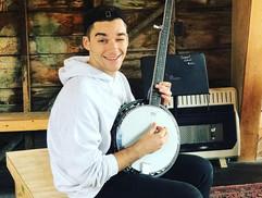 Alex LOVES the banjo