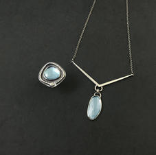 Custom blue topaz ring and necklace