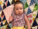 Olivia with her quilt June 2019.png