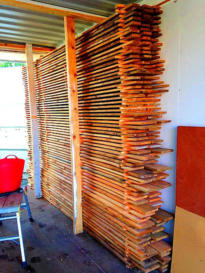Pile of timber planks edit.jpg