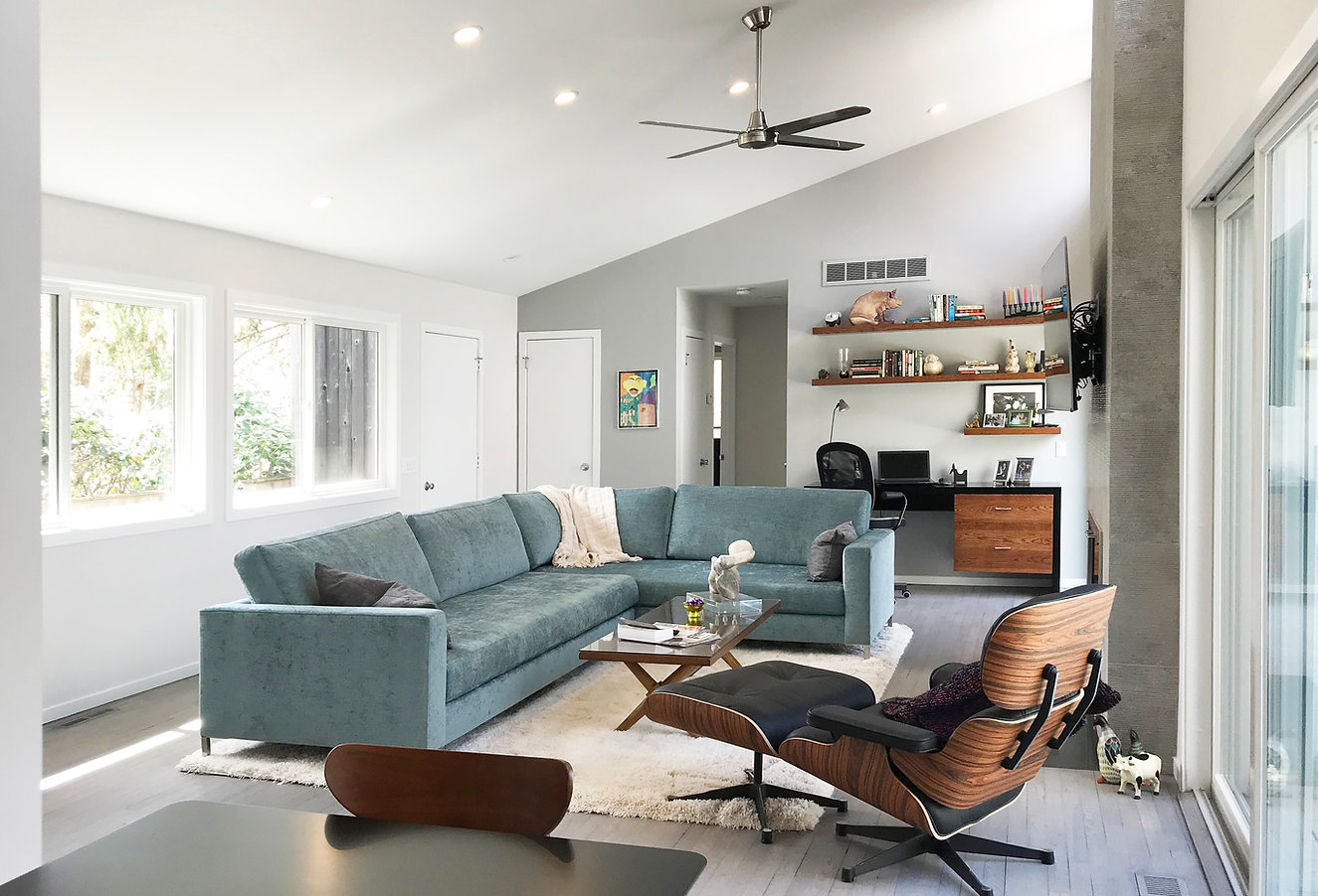 Midcentury modern design hamptons, blue sectional, teal couch, eames chair, accent walls, whit shag rug