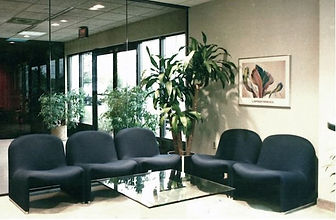 Commercial Interior Design, Reception Area, modern office chairs, glass coffee table, gray walls, contemporary style office