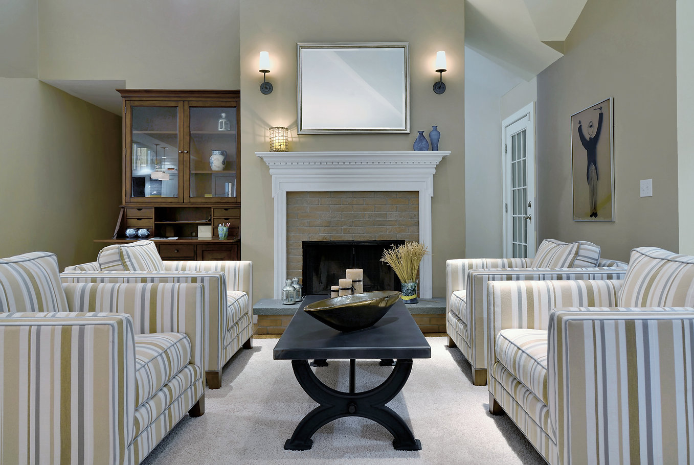 Southampton interior design,  transitional living room, living room seating area, striped chairs, brick fireplace, metal coffee table, beige and white liing room, white shag rug