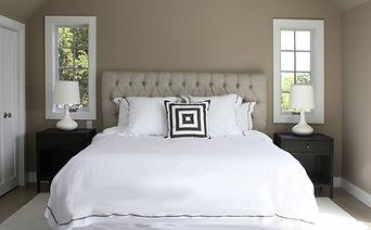 master bedroom, tufted headboard, beige walls, casement windows, linen headboard, white lamps, metal nightstands, white shag rug