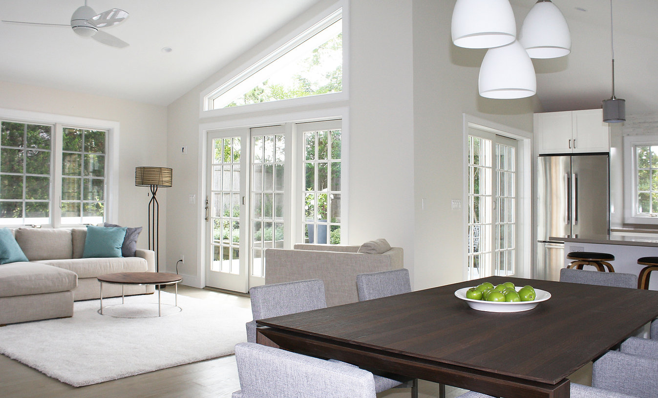 Beach Cottage interior design, open plan, sliding doors, white rugs, neutral colors, wood dining table, contemporary interior design, Amagansett