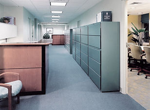 Commercial office design, reception area, commercial interior desgn, file cabinets, wood reception desk, teal blue, tan conference room chairs