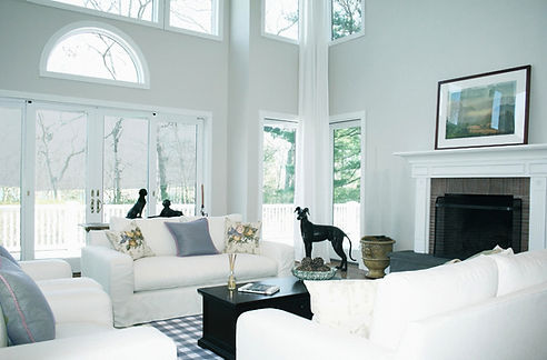 white couches, white walls, white paint, blue throw pillows, blue and white room, traditional fireplace mantle