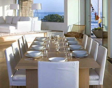 Oceanfront, dining, white dining chairs, white sofa, oceanfront, light wood table, modern interior