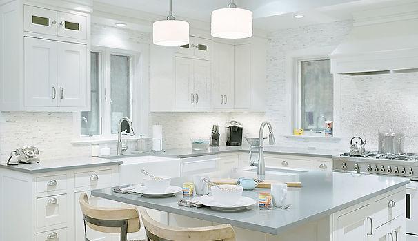 transitional kitchen design, white kitchen, tile backsplash, gray countertop, quartz countertops, kitchen island, stainless kitchen cabinet handles, pendant fixtures, kitchen lightng