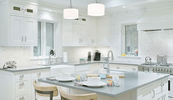 transitional kitchen design, white kitchen, tile backsplash, gray countertop, quartz countertops, kitchen island, stainless kitchen cabinet handles, pendant fixtures, kitchen lightng