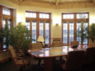 Confernce Room, wood conference table, wood arm conference chairs, yellow walls,