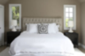 Interior Design Bedrooms, Bedroom Design, Interior Design Amagansett, Best Decorators Hamptons NY, Upholstered headboard, beige headboard, brown walls, brown pait, casement windows, white linens, nightstands, metal nightstands, dark gray nightstands, white rug,
