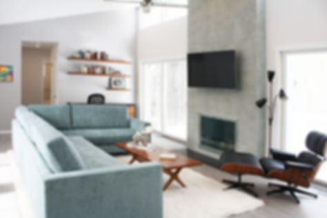 east hampton interior design, blue sofa, eames chair, midcentury modern