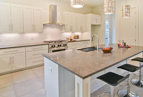modern kitchen design, porcelain tile, brown countertop, stainless hood, large kitchen islandblack stools,