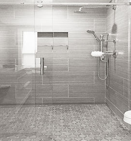 Modern bathroom, walk-in curbless shower, mosaic tile floor, porcelain wall tiles, hand held shower head, rain head shower head
