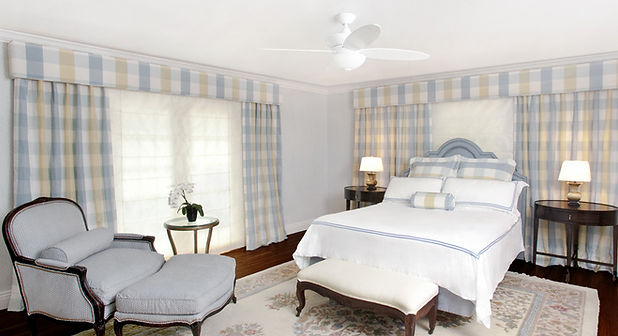 blue and yellow bedroom, blue upholstered side chai, plaid drapery, sheer drapery, traditional rug, white upholstered bench, traditional furnture, mahogany nightstands, dark wood floors