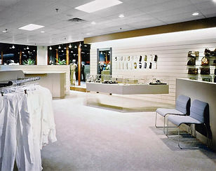 Retail design, women's clothing store, gray and pink, glass display cabinet