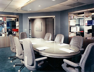 Commercial design office design coference room gray wood desk with gray tweed coference chairs, teal carpet, custom built in cabinetry