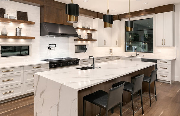 white kitchen, wood cabinets, marble island, waterfall countertop, black stools, open shelving kitchen, black and brass lighting, black hood, wood trim kitchen