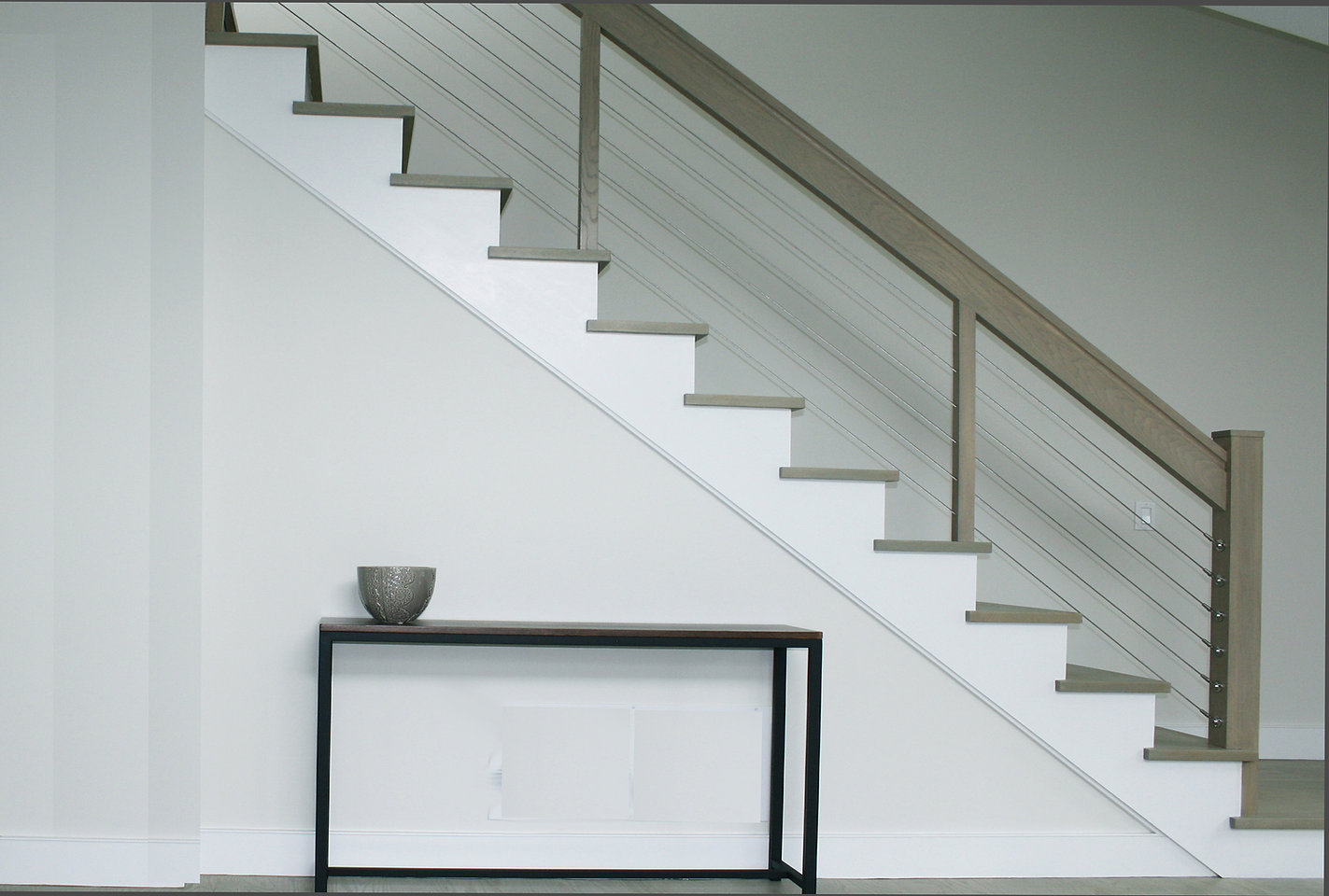 cable stairs, wire handrail, wood treds, white stringers, wood handrail, modern stairway, modern stair design