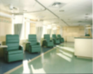 Medical office design, chemotherapy chairs, happy colors, green and yellow interior, vinyl flooring, cubicle curtains, medical reception desk