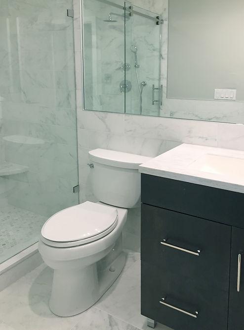 Bathroom renovation Montauk, small bathroom design, wood bathroom vanity, marble bathroom, montauk renovation, befores and afters bathrooms, small bathroom ideas