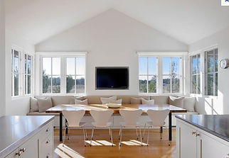 Modern farmhouse kitchen eating area, banquette, white kitchen, wood floors, sag harbor interior design