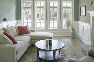 traditional den, sag harbor interior, traditional interior design in the Hamptons, beige sofa, oriental rug, fireplace mantle
