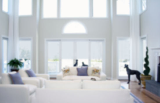 white interior, white furniture, white couches, blue pillows, blue and white, white drapery, natural light, high ceilings, contemporary interior