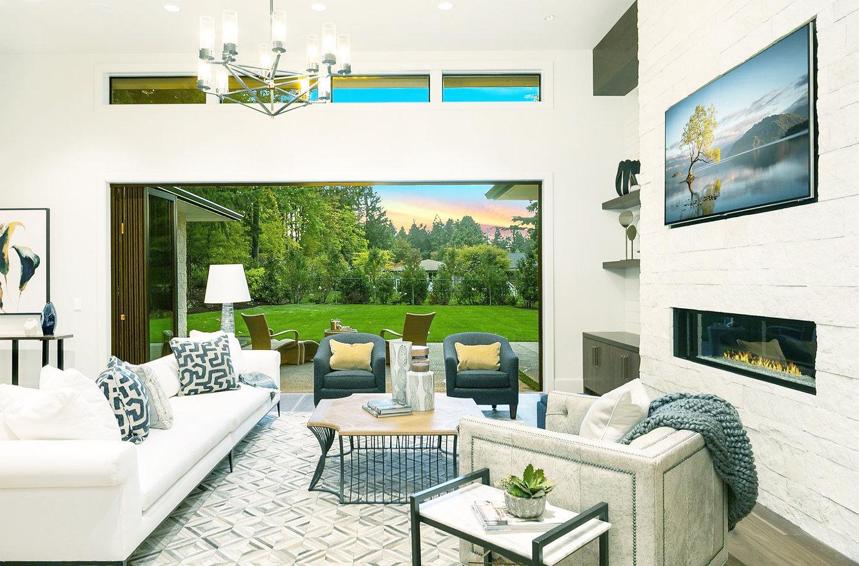 Living Room w stone fireplace wood floor