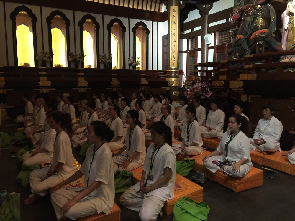 Students meditating in the main shrine of Longfu Temple