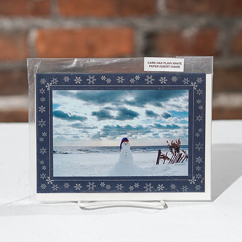 Snowman on a beach greeting card