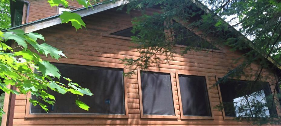 The Muskoka room peeking through the trees.