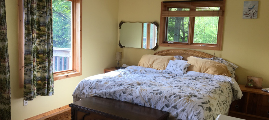 The bright and airy main bedroom.