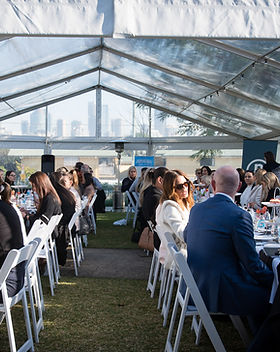 Corporate event held under a marquee on the front lawn of Hanworth House